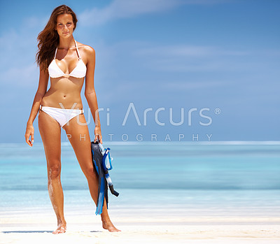 Full length of young beautiful woman all set for scuba diving at beach