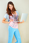 Beautiful young girl holding laptop