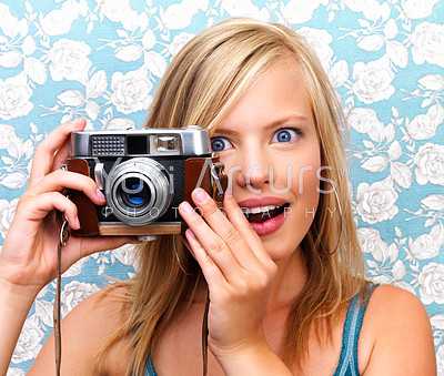Close up of a girl clicking camera smiling