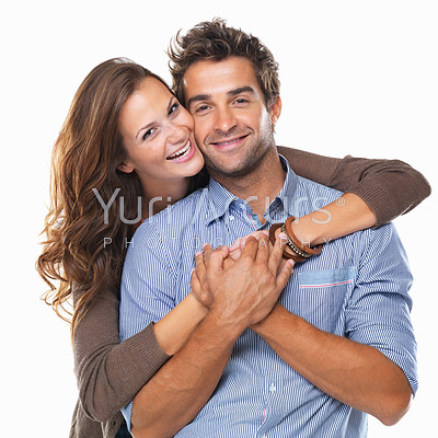 Portrait of an attractive couple smiling with woman hugging man from behind