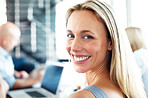 Smiling young casual businesswoman in a meeting