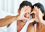 Couple making heart gesture