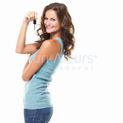 Portrait of woman holding car keys and smiling on white background