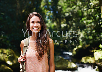 Shot of a beautiful young woman hiking in the forest