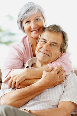Buy stock photo Portrait of a cute senior couple sitting together with arms around