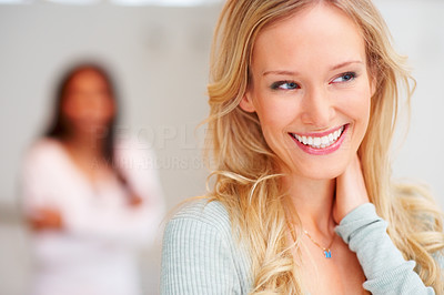 Buy stock photo Closeup of a beautiful young woman smiling and looking away, with a blurred image of a woman in the background
