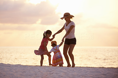 Buy stock photo Portrait of happy mother with daughters playing on the beach