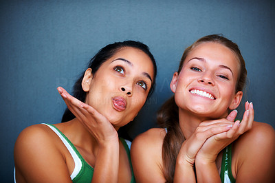 Buy stock photo Portrait of pretty young girls making funny faces against grey background