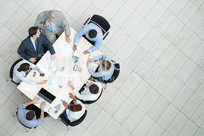 Top view of successful business people sitting at a table for meeting with copyspace