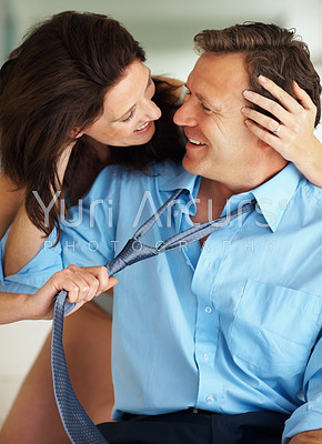 Happy and intimate mature couple during foreplay