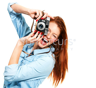 Portrait of an attractive redhead taking a picture of you