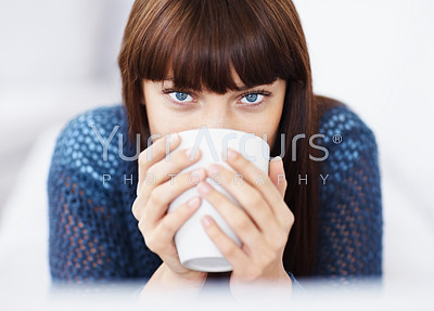 Detail view of a beautiful young woman drinking coffee