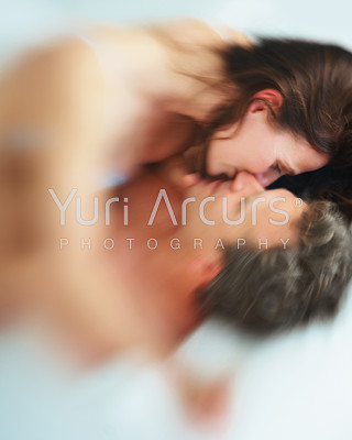 Foreplay - Blur image of a man and woman getting passionate in bed