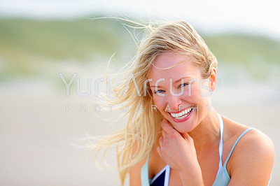 Portrait of a lovely young smiling woman while at the beach