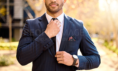 Buy stock photo Shot of a businessman adjusting his tie