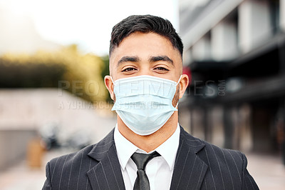 Buy stock photo Shot of a young businessman wearing a protective face mask