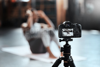 Buy stock photo Shot of an unrecognizable woman recording her workout at the gym