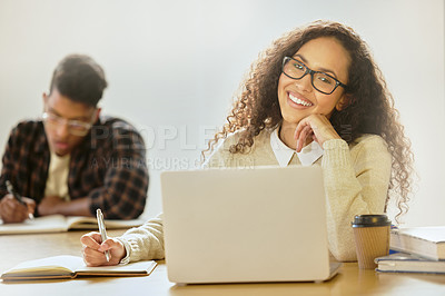 Buy stock photo Cropped portrait of an attractive young female college student working on her laptop while sitting in class