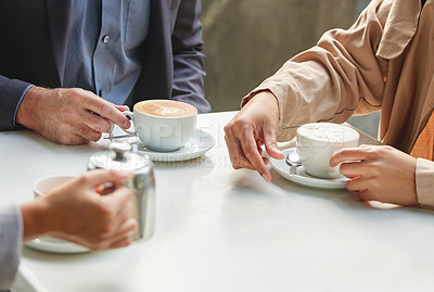 Buy stock photo Shot of a group of coworkers having a meeting at a coffee shop