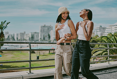 Buy stock photo Shot of two young female friends spending a day in the city